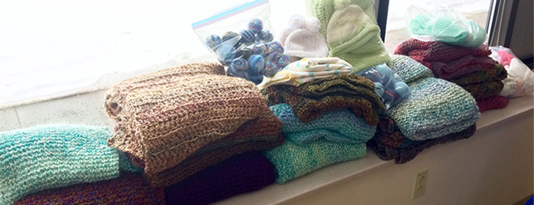 a variety of items knitted by the CVMC knitting group