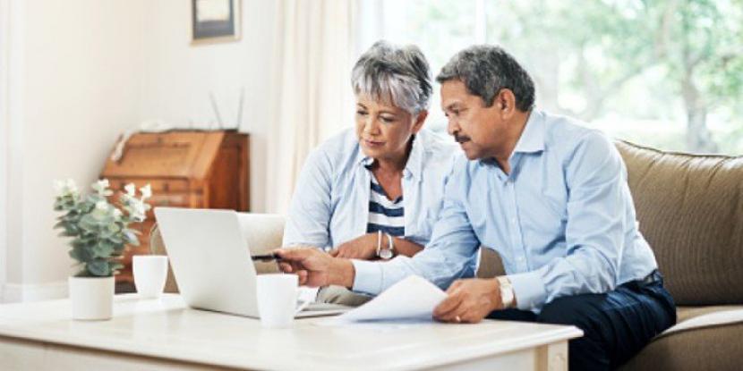 Older couple using laptop together