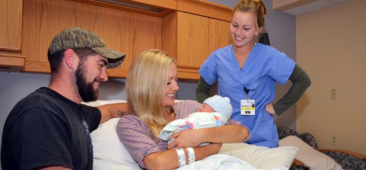 Couple with newborn and nurse