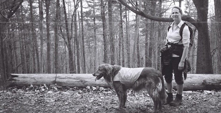 Mary Oliphant in woods with dog