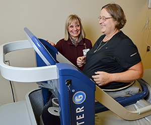 UVMHN-CVMC Physical Therapist Susan Stephen, PT works with Candace Brown on the AlterG