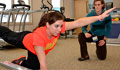 Physical therapist watching patient perform exercise