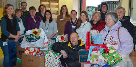 CVMC Staff with Adopt-A-Family Gifts