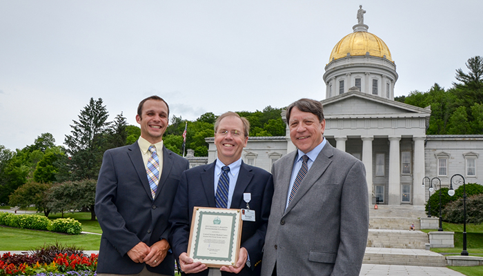 Tim Perrin, Richard Morley and Leo Martino hold Governor's Award in front of state house