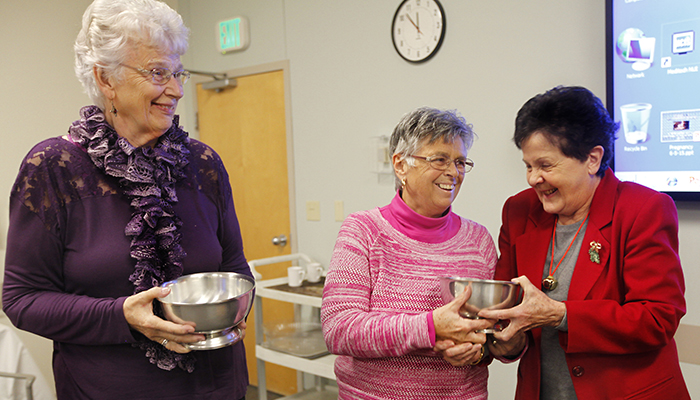 Wanda Baril recently presented Marilyn White, left, and Joni Argenti, center, with the 2015 CVMC Auxilian of the Year award