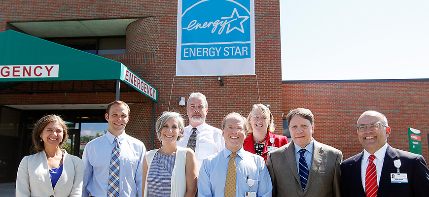 CVMC's Energy Savings Initiative team standing in front of Energy Star banner
