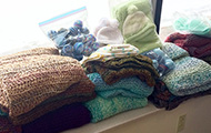 Stacks of yarn products knitted for CVMC patients