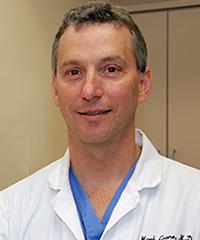 Mark E. Crane, MD