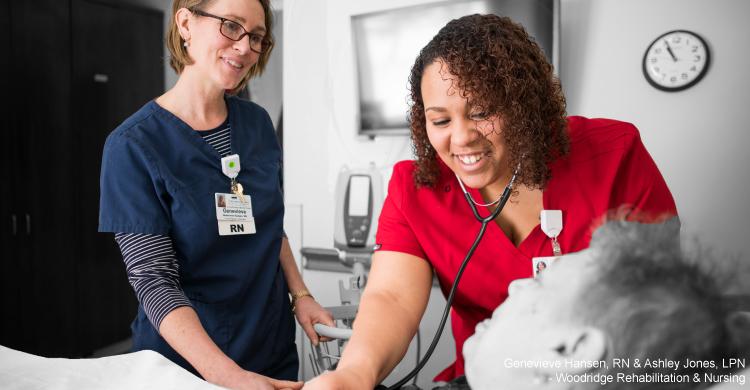 Nurse listening to patients heart