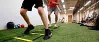 Athletes navigating ladder at CVMC Rehabilitation Therapy's new sports area