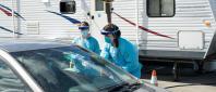 CVMC health care providers conducting COVID-19 testing at popup