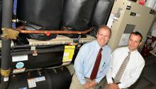 Richard Morley, CVMC Vice President of Support Services (left) and Tim Perrin, Senior Account Manager at Efficiency Vermont (right), in front of CVMC's Templifier.