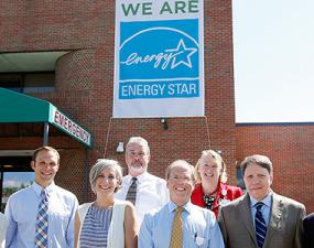 CVMC staff stands in front of Energy Star banner